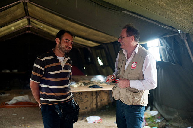 Abdalkarim Zahra, from Syria, is interviewed by Caritas Germany Communications Officer, Stefan Teplan, at Vasariste, a refugee aid point, in Kanjiza, Serbia. Photos by Kira Horvath for Catholic Relief Services