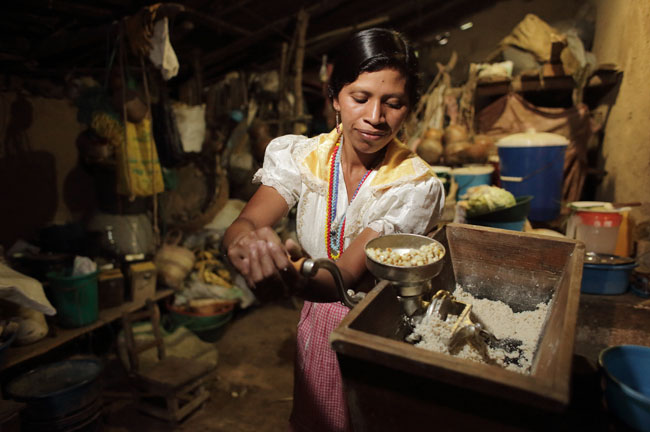 Woman making flour in Guatemala. Photo by Caritas