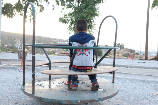 A Syrian boy in an abandoned park in Lesbos, Greece, now a refugee camp. Credit: Patrick Nicholson/Caritas