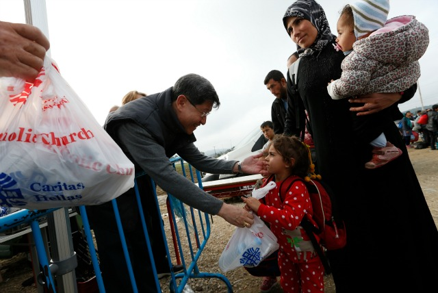 Cardinal Tagle takes part in a Caritas aid distributions to refugees and migrants at a border crossing in Greece. Paul Haring/CNS/Caritas