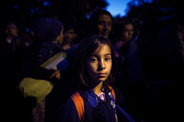 Ilahi, 7, from Afghanistan, prepares to crosse the Serbia/Croatia border with her family, at Berkasovo, Serbia. Photo by Andrew McConnell for Catholic Relief Services