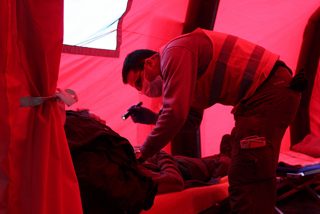 Bahrang Mostaag (32), volunteer medical student with Caritas Hungary treats a patient in the ambulance tent at Dobova refugee camp, Slovenia. Credit: Meabh Smith/Trocaire/Caritas