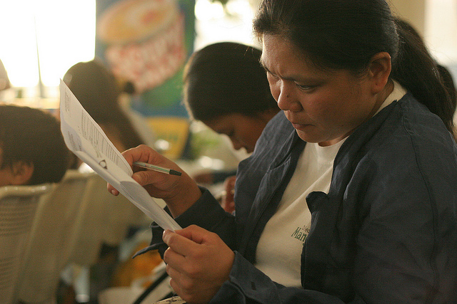 Returning migrants fill up the necessary forms upon their arrival home. IOM repatriated Filipinos stranded in Lebanon , many of whom are migrant workers. Photo by International Organization for Migration