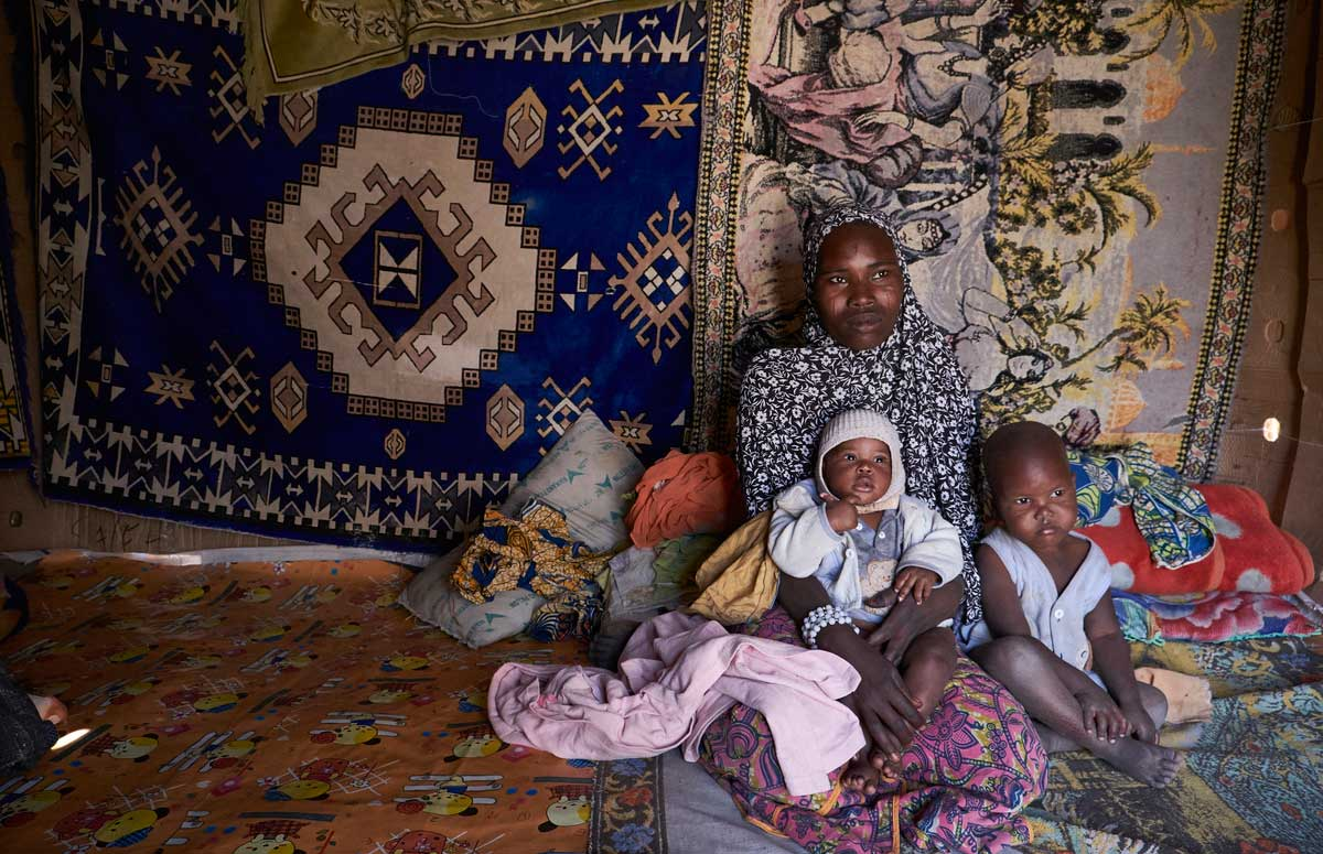 Falmata and her children in the village of Guidan Kaji near the border with Nigeria on the outskirts of Diffa, Niger on February 13, 2016. Photo by Sam Phelps/Caritas