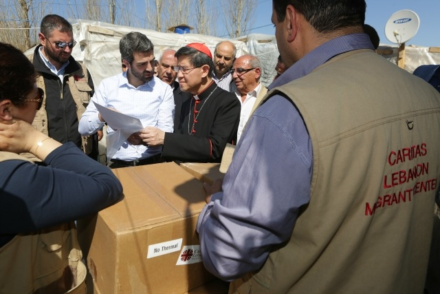 Cardinal Tagle on an aid distribution to a refugee camp in Lebanon's Bekaa Valley. Credit: Caritas