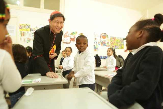 Cardinal Tagle visited a Caritas school for the toddlers of migrant workers. They don't have access to state schools, can't afford private ones, so would either have to go back to their home countries or not lose out on an education. The lessons are built around understanding rights. Credit: Caritas