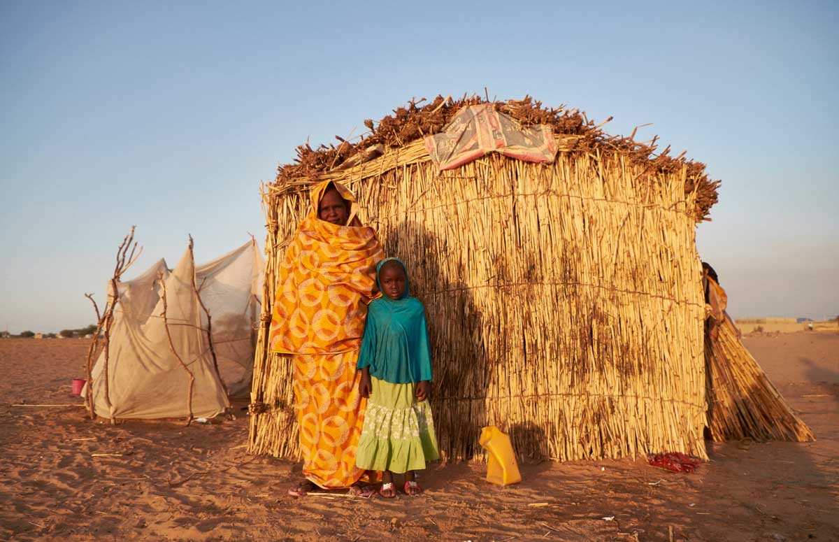 Djarou Ali, 45 and her daughter Hawa Babacar at a camp of displaced people in the neighbourhood of Chateau, Diffa, Niger on February 12, 2016. Photo by Sam Phelps/Caritas