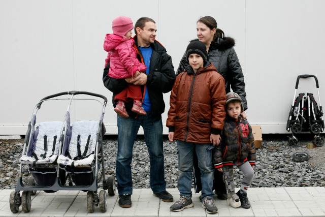 Alexander Ortynskiy with three of his six children at the Modular Village. Credit: Matthieu Alexandre/Caritas
