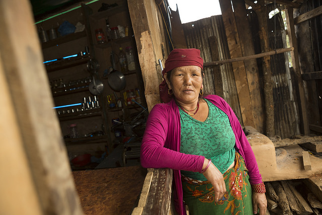 Kumari Gurung (54) is a beneficiary of CRS' Market Recovery Program in Hansapur VDC, Gorkha District, Nepal. CRS helped clear away her destroyed hotel and will provide additional support for her business in the future. Photo by Matthieu Alexandre/Caritas