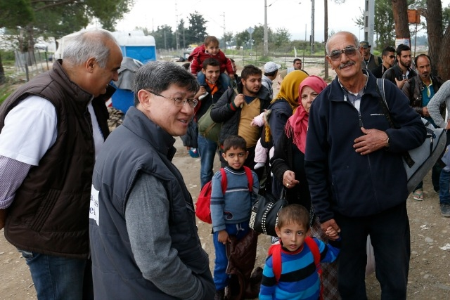 Cardinal Tagle with recently arrived refugees in Greece. Credit: CNS photo/Paul Haring