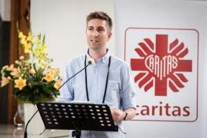 Daniel Hale rom CAFOD speaking at #YoungCaritas' World Youth Day event