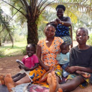 Ivoirians fleeing to Liberia meet widow's might