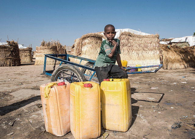 In Maiduguri, NE Nigeria, people displaced by Boko Haram violence collect water from a community borehole. Michael Stulman/CRS