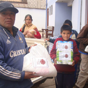 Caritas distributing aid in flood affected areas in Peru