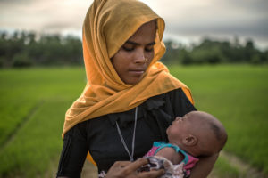 Rajida Begum, 30, holds her still-unnamed 14 day old baby, who was born in a rice paddy as Begum fled the Burmese army.