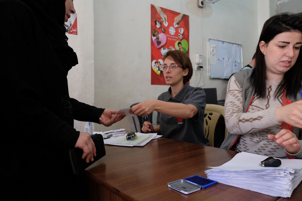 Amira Macharekji (centre) is an M&E officer for Caritas in Jabal Badro in Aleppo.