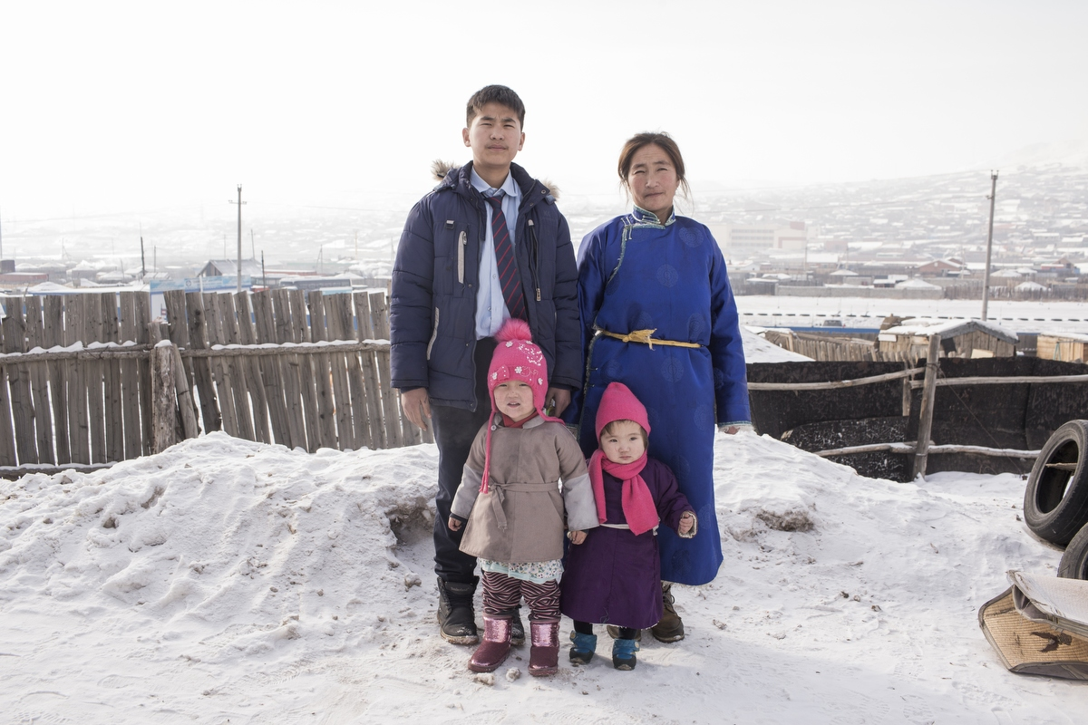 """We lost most of the herd in the winter of 1996 and 1997,"" says Bayarsaikhan. ""The rest died in the dzud of 2006 and 2007."" Bayarsaikhan and his wife Erkhembayar now live with their six children in a ger in Ulaanbaatar. ""It's impossible to live as a herder,"" says Erkhembayar. ""Our children have to be in school. That's difficult when you move from place to place. In a town, the children can live at home and go to school."" Around a fifth of Mongolia's population has moved to Ulaanbaatar in the past three decades, doubling the city's population. The rapid increase has put pressure on infrastructure."