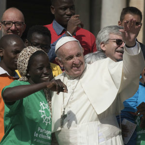 Pope Francis launching the Caritas Share the Journey campaign with refugees and migrants