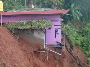 A house in Kerala it at risk of sliding down the hill because of floods and mudslides.