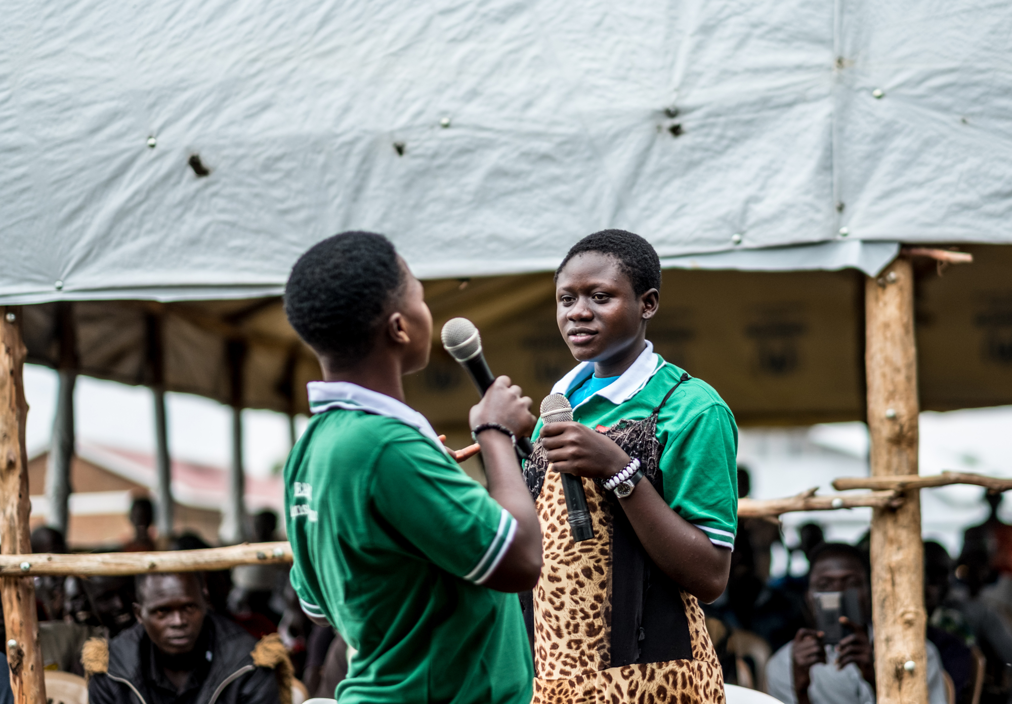 A drama group performs a skit about the dangers of child marriage during an event staged by Caritas in Bidibidi camp, Uganda.