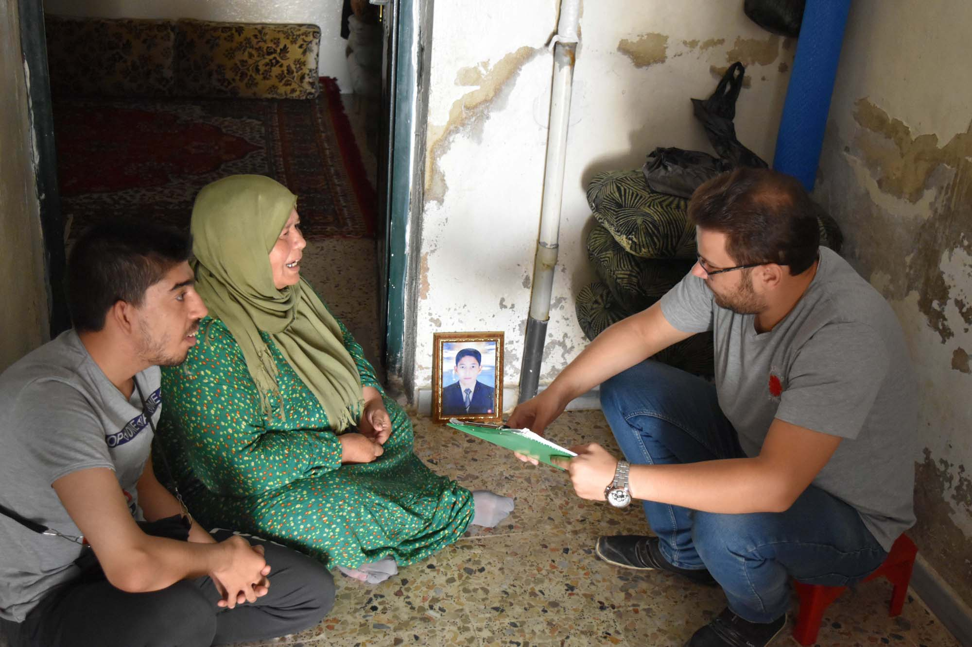 Caritas Syria staff regularly visit Fowziah in her home,.