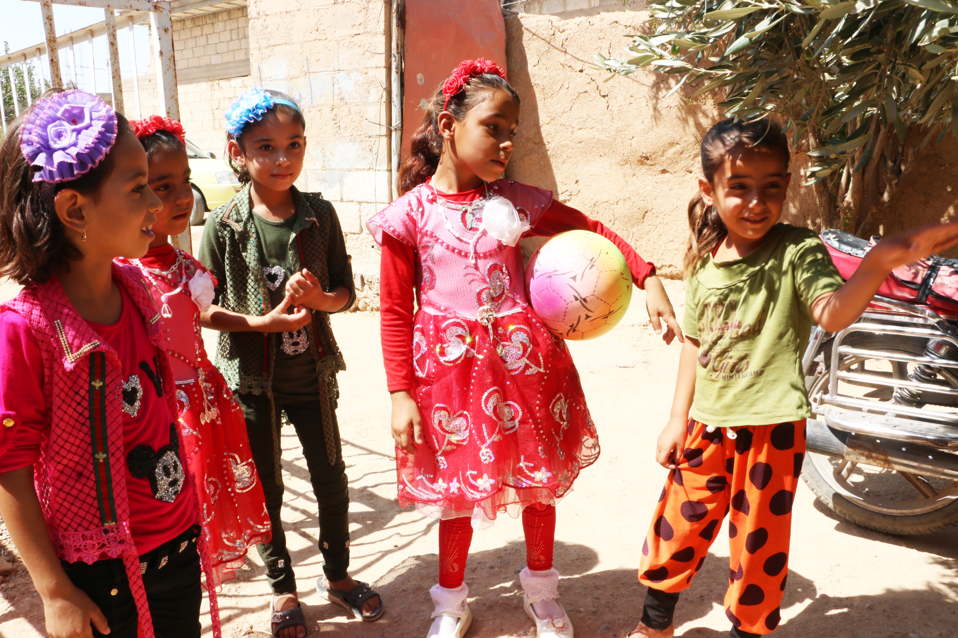 Mohammed's children can play with their friends thanks to help from Caritas Syria