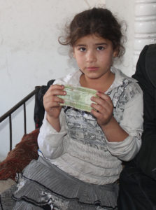 Lena's daughter holding a bank note