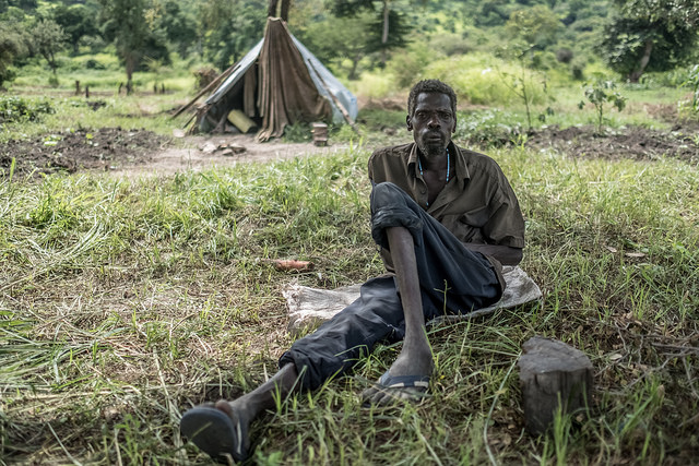 Alana John, 53, has lived in this tiny, leaking tent for over a year, since he fled fighting in Pajok, South Sudan.
