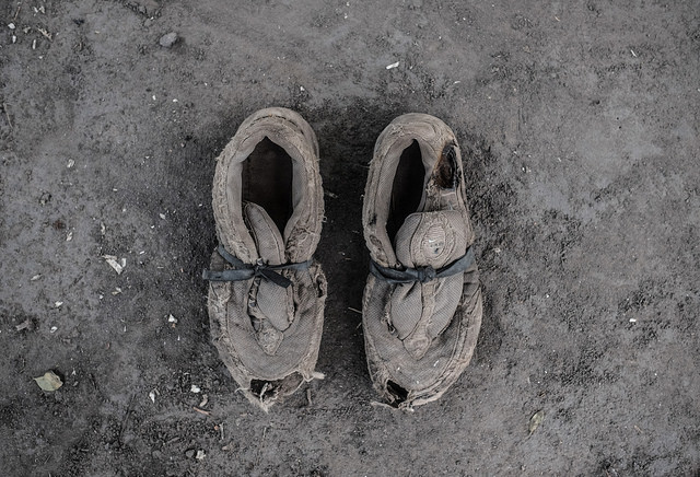Broken shoes belonging to South Sudan refugee Okongo Charles