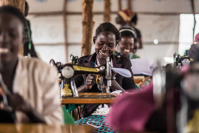 Nancy Tabu, a refugee in Bidibidi refugee camp, takes part in a Caritas-supported tailoring class.
