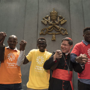 Cardinal Tagle says combat hate by walking with migrants and refugees