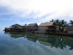 Vulnerable coastal homes in Papua New Guinea. Photo: Adrian Watson