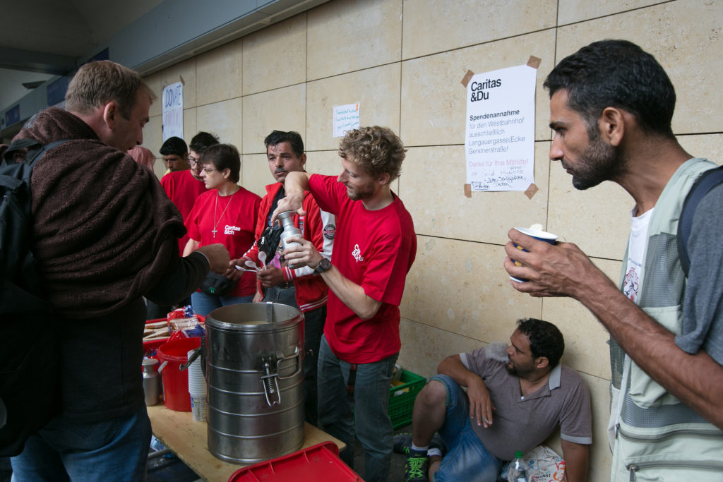 Caritas volunteers welcomed and helped migrants when they arrived in Vienna in 2015.