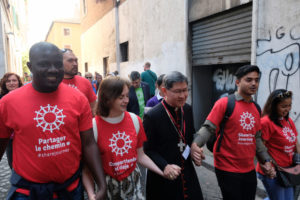 Cardinal Tagle walking with migrants in Rome. (Photo: Caritas/Patrick Nicholson)