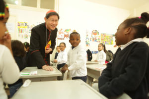 Cardinal Tagle met children at school for migrant workers and refugees in Lebanon in 2016.