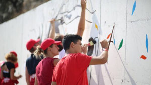 Young adults painting murals in Lebanon schools