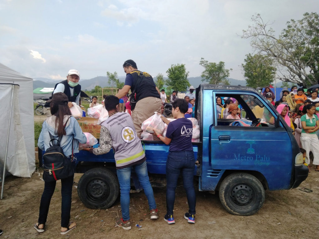 Caritas distribution of aid to thousands of household affected by the earthquake.