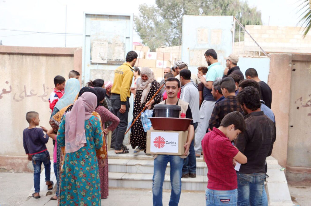Aid distribution in Caritas Hasakah