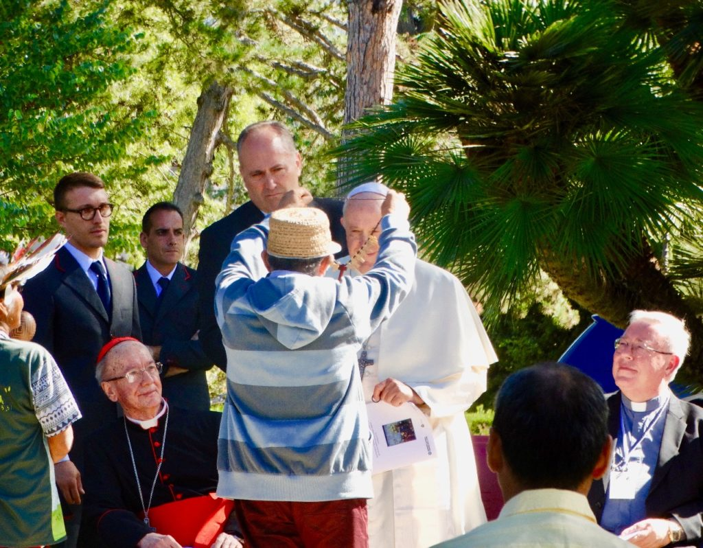 Pope Francis received a necklace from an indigenous chief or cacique.