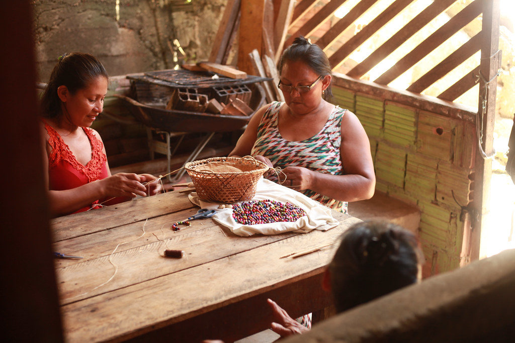 Cilene Perereira is making necklaces from seeds and woven threads