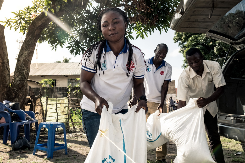 Caritas staff prepare sacks of food for people affected by Ebola in Beni, DRC.