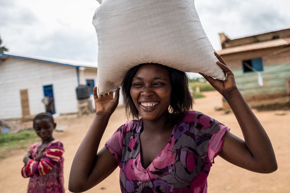 Anita Promesse, 19, collects food from Caritas in the Ebola-hit town of Mambasa, DRC. Promesse's family has been short of money and food since the epidemic hit local markets.