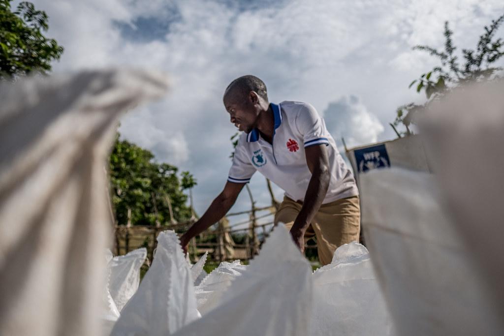 Caritas staff prepare sacks of food for people affected by Ebola in Beni, DRC.
