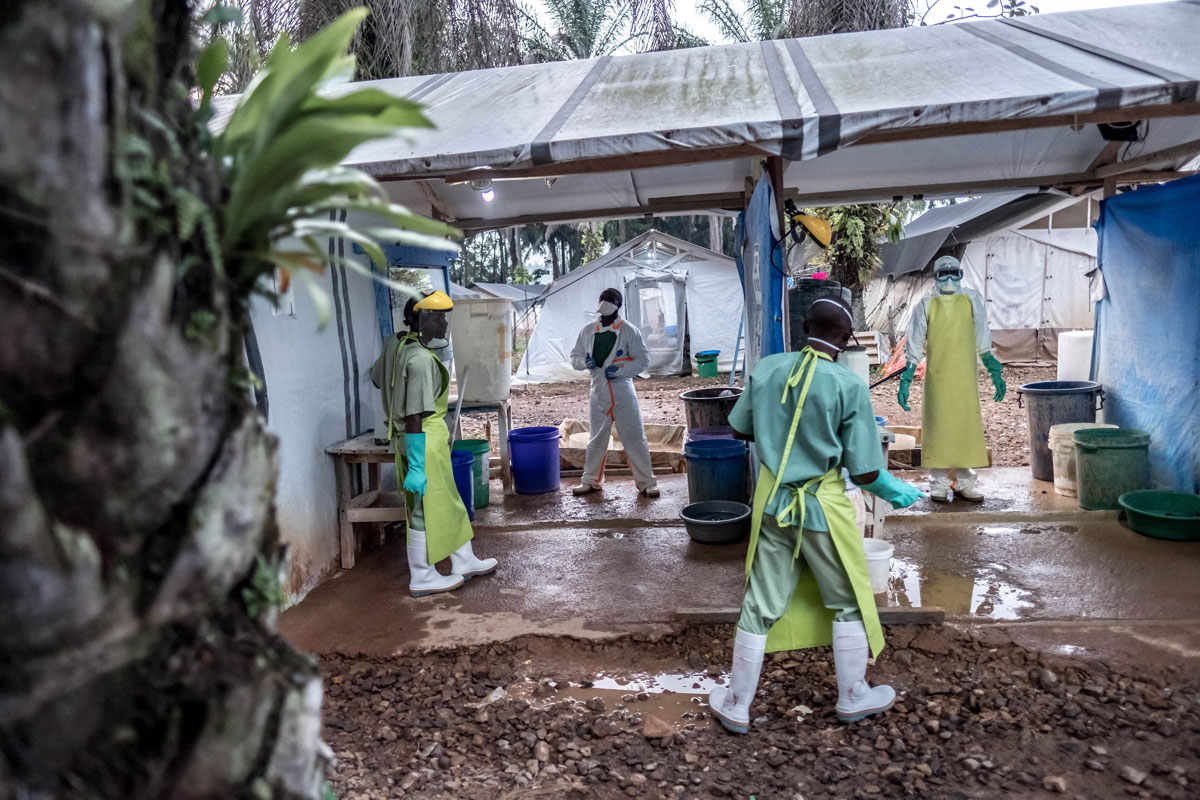 An Ebola worker is sprayed down with chlorine on leaving the red zone in a Caritas-supported Ebola treatment center in Mangina, DRC.