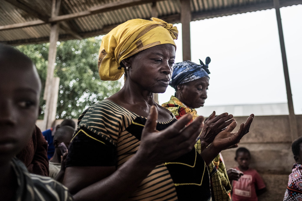 People pray before mass at a church service in the Ebola-hit town of Mambasa, DRC.