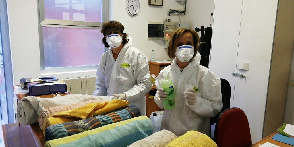 Caritas Lodi volunteers in Italy prepare towels for homeless people who come to Caritas to shower.