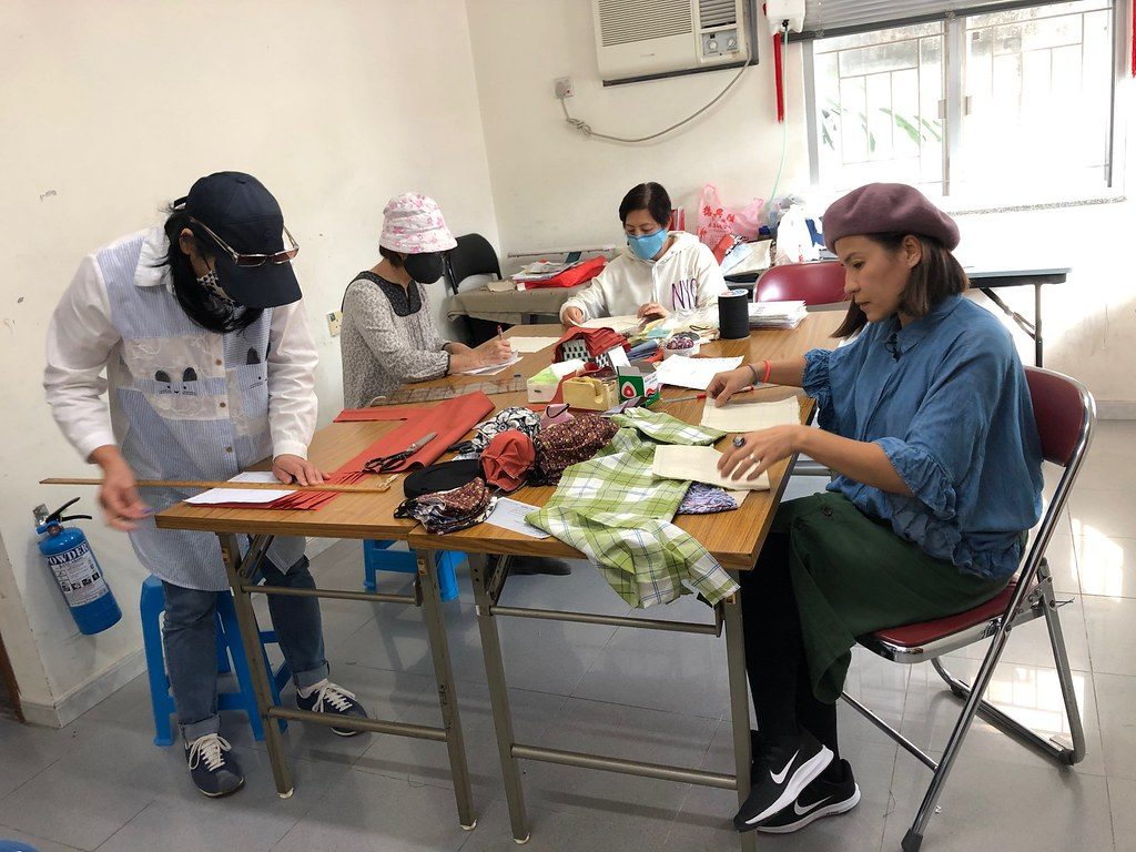 Volunteers from Caritas Hong Kong set up a project to design and sew cloth masks