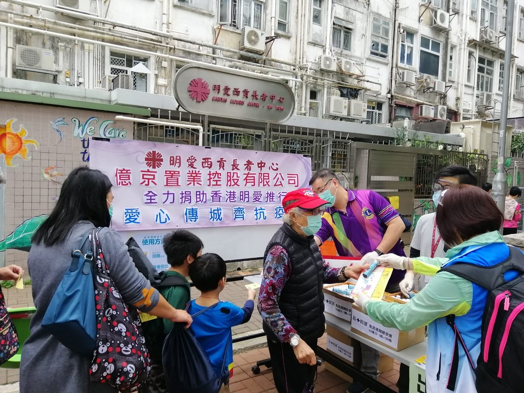 Volunteers and staff of Caritas Hong Kong teach the communities who cannot afford or did not find the source to buy face masks how to sew cloth masks.