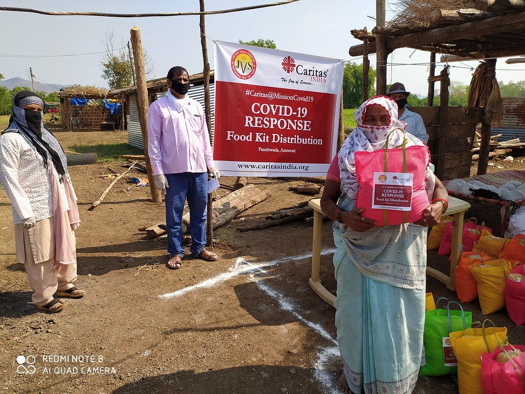 Caritas India promotes social distancing at a food distribution