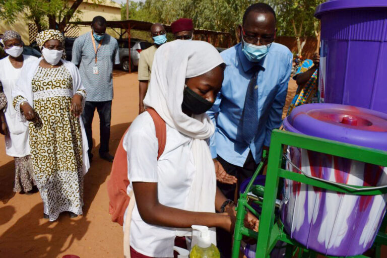 Students of Mariama School use Caritas handwashing station.